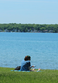 A student finds some quiet study time at Gull Lake.