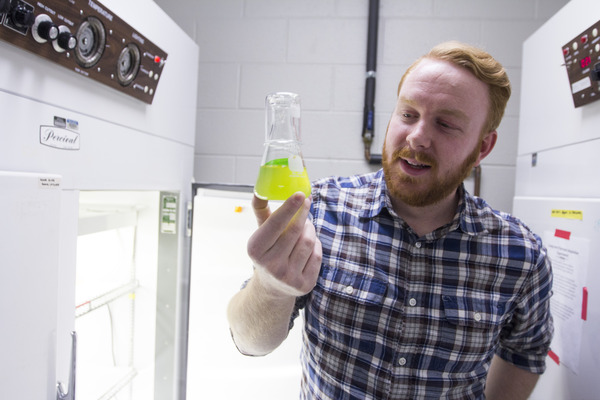 Jake Nalley examines his algae samples.